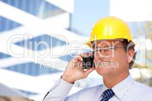 Contractor in Hardhat and Necktie Talks on His Cell Phone