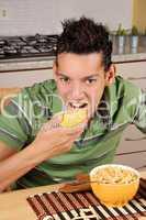 Young man having breakfast
