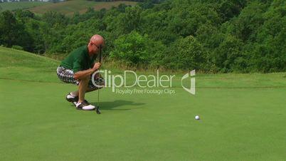 Golfer Sinks Putt 04