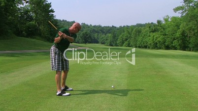 Golfer Teeing Off With Driver 03