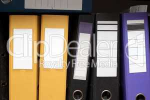 Folders on a shelf