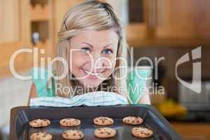 Cute young woman baking cookies