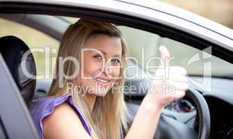Smiling female driver with thumb up