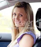 Portrait of a smiling young female driver