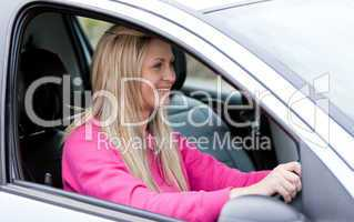Attractive female driver at the wheel