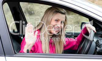 Joyful young female driver at the wheel