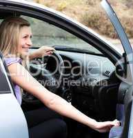 Jolly female driver at the wheel