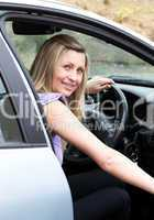 Young female driver at the wheel