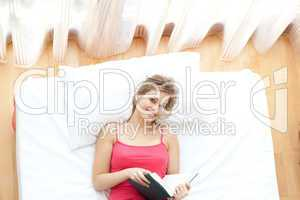 Radiant young woman reading a book