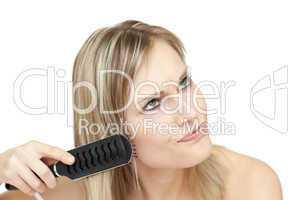 Annoyed woman bruishing her hair