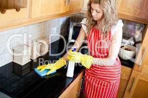 Charming woman doing housework