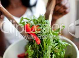 Afro-american woman preparing a salad