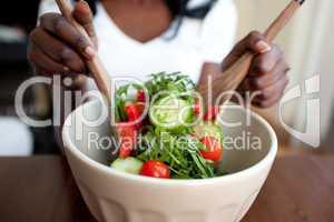 Ethnic woman preparing a salad