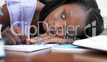 Exhausted teen girl resting while studying