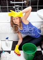 Annoyed woman cleaning bathroom's floor