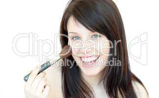 Happy woman using a powder brush