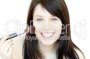 Jolly woman using a powder brush