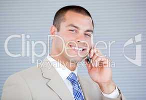 Assertive businessman talking on phone