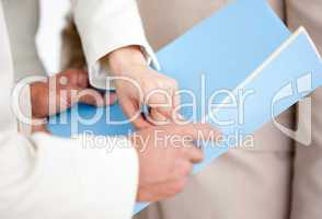 Close-up of a businesswoman pointing at a document