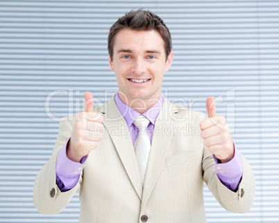 Successful businessman with thumbs up