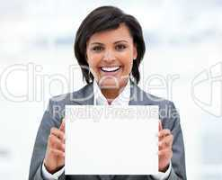 Smiling ethnic businesswoman holding a white card