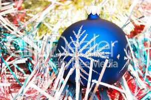 Blue christmas ball on the shiny decoration