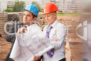 Director with subordinate on construction site