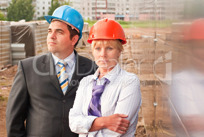 Director with subordinates on construction site