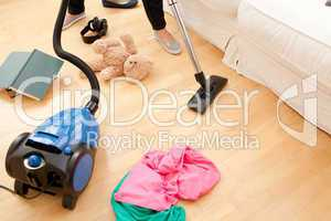 Woman vacuuming the living-room