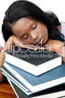 Sleeping student leaning on a stack of books
