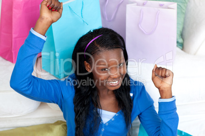Joyful woman punching the air in celebration after shopping