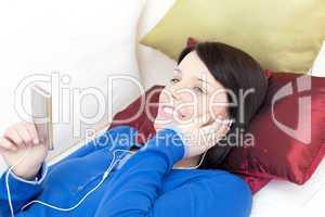 Happy woman listening music with headphones