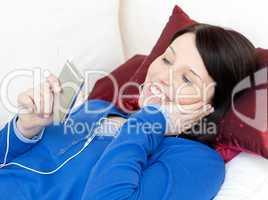 Cheerful woman listening music with headphones