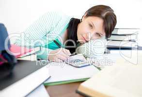 Bored teen girl studying
