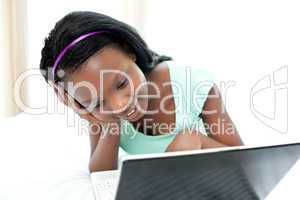 Happy teen girl surfing the internet