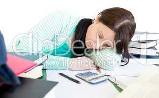 Sleeping teen girl studying