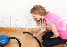 Portrait of a charming woman vacuuming