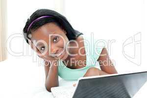 Jolly teen girl surfing the internet