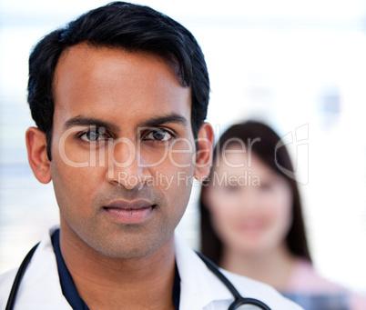 Portrait of a confident ethnic doctor