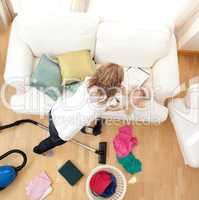 Blong young woman doing housework