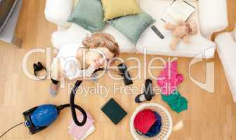 Smiling blond woman vacuuming the living-room