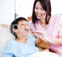Cheerful little boy attending a medical exam