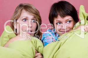 Two girl watching a scary movie
