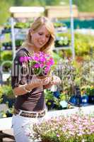 Pretty blond woman in gardening center