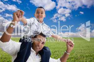 Father and Son Over Grass Field, Clouds and Sky