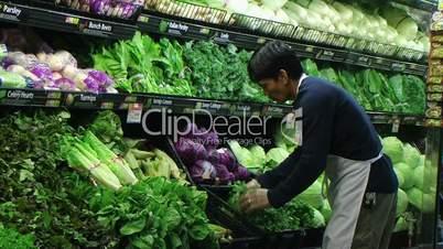 Man Facing Lettuce In Produce