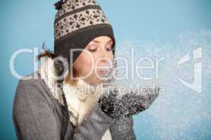 Woman blowing the snow