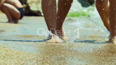 Legs of people on the beach