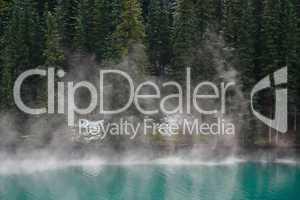 Mist rising from alpine lake