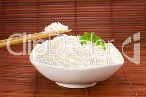 Bowl of rice on mat